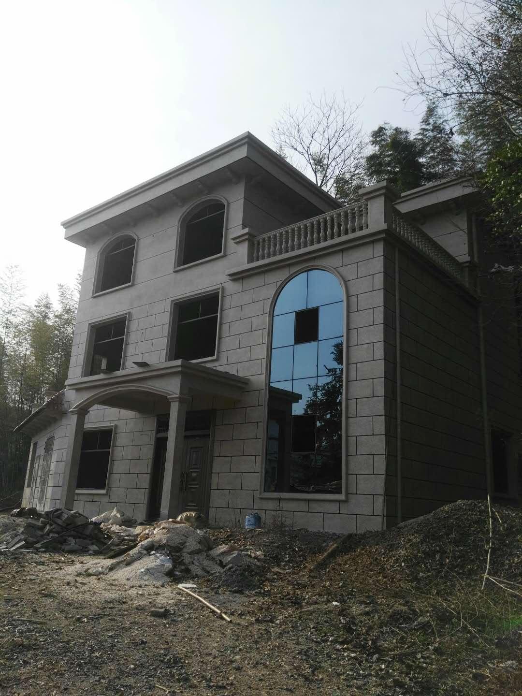 云南省丹凤镇农村外墙水包水多彩仿石漆案例